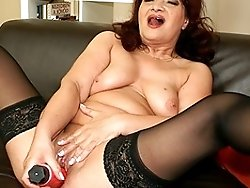 This horny mama loves playing with her toys