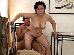 After fucking the mature pussy in a couple of positions he creams on her pretty face