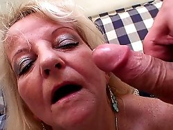 The hardcore double team features a granny slut in stockings with a hairy pussy taking it