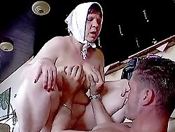 Horny old woman fucked hard on a bar stool